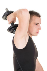 Sporty man doing exercise to strengthen his triceps.