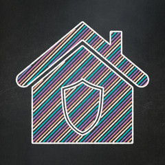 Finance concept: Home on chalkboard background