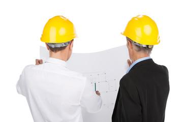 two man wearing yellow helmets.