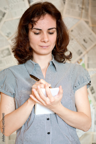 Young journalist woman writing
