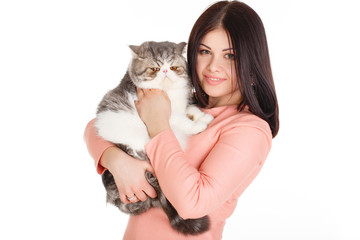 beautiful smiling brunette girl and her big cat on a white