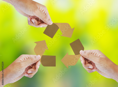 Paper recycle sign in hands