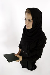 A Young Arab Woman Hands Over Her Passport