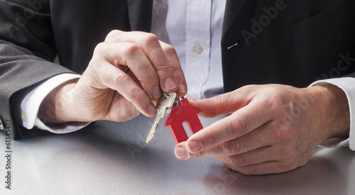 real estate hands giving home key