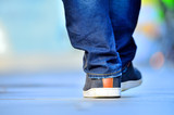 Close up of person walking on street - 61345810