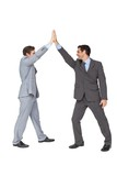 Unified business team high fiving each other