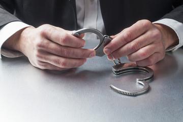 justice at work with handcuffs in hands