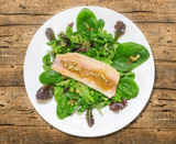 green salad with spinach,smoked trout and onion dressing