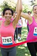 Breast cancer participants winning marathon race