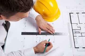 professional architect drawing construction plan.