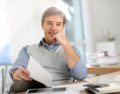 Portrait of senior businessman in office