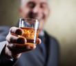 Vintage businessman holding a glass of whisky
