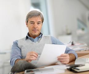 Portrait of senior businessman in office
