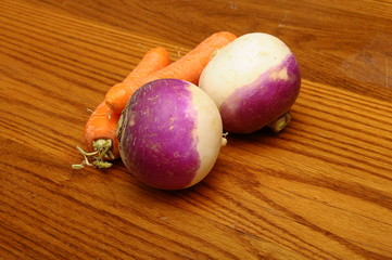 Purple turnips on wooden table