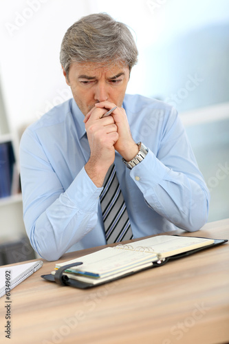 Businessman with worried expression on his face