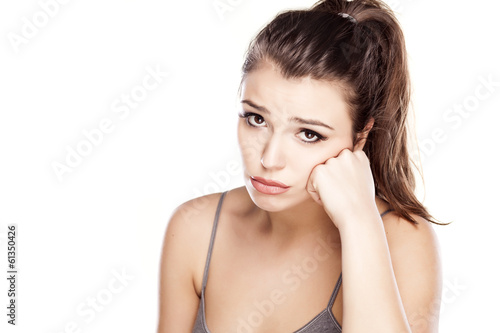 pretty sad young woman on a white background