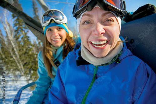 Happy snowboarding girls