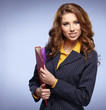 picture of a young attractive businesswoman with folders