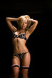 hot woman in lingerie in dark