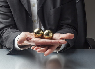 zen balls in hands for stress management