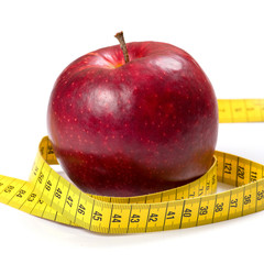 apple with tape on white background (health and diet concept)