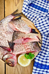 Bream raw on board with a knife and napkin