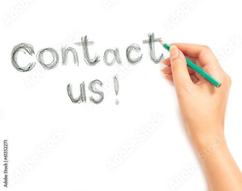 Woman's hand writing contact us on white