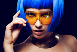 Portrait of beautiful girl with blue hair and glasses