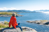 Woman enjoying view at fjord