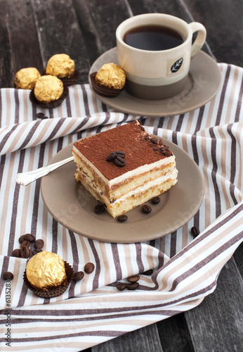 Fototapeta Portion of delicious tiramisu cake