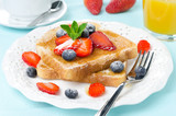 crispy toast with honey, fresh berries, coffee and orange juice