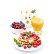 fresh breakfast with waffles, berries and orange juice, isolated