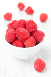 fresh raspberries in a bowl, vertical