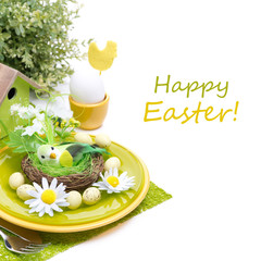 Festive Easter table setting with decorations, egg and flowers