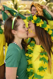 Brazilian girlfriends soccer fans kissing each.