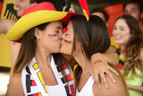 Sport soccer fans kissing each other celebrating.