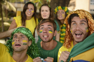 Astonished group of Brazilian sport soccer fans