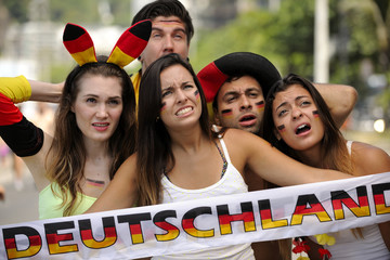 Happy group of astonished German sport soccer fans