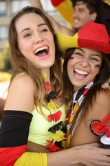 Happy German girlfriends sport soccer fans celebrating