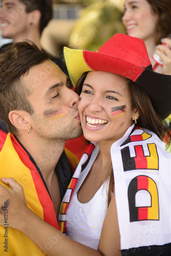 Sport soccer fans celebrating victory kissing.