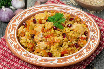 pilaf with chicken and vegetables on a plate