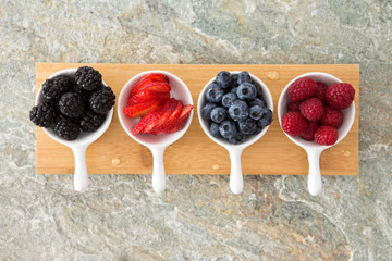 Assorted fresh berries in taster dishes