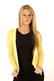 beautiful long blonde haired woman wearing yellow cardigan