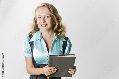 Girl with book on white background