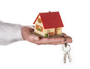 Haus mit Hand und Schlüssel