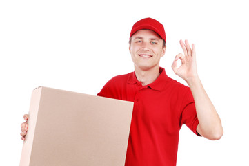 Courier in red uniform with a big box showing ok gesture