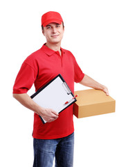 Young man courier in red holding a box isolated on white
