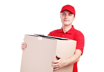 Delivery man with a big box isolated on white