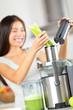 Vegetable juice - woman juicing green vegetables