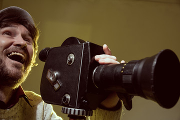 Portrait of cheerful man with a beard makes movies